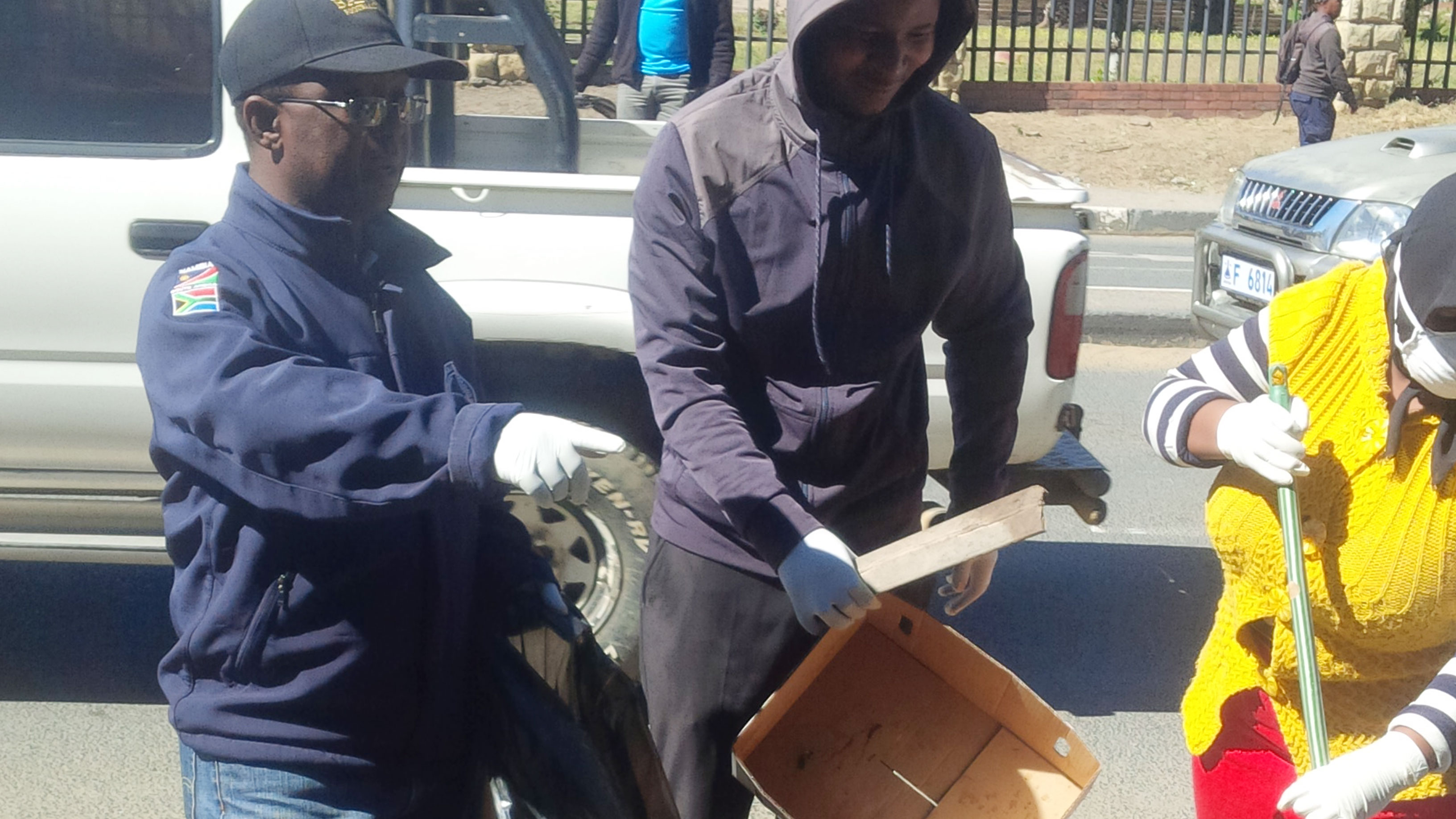 Ministry staff cleaning Maseru street in celebration of 50 years of Independence.