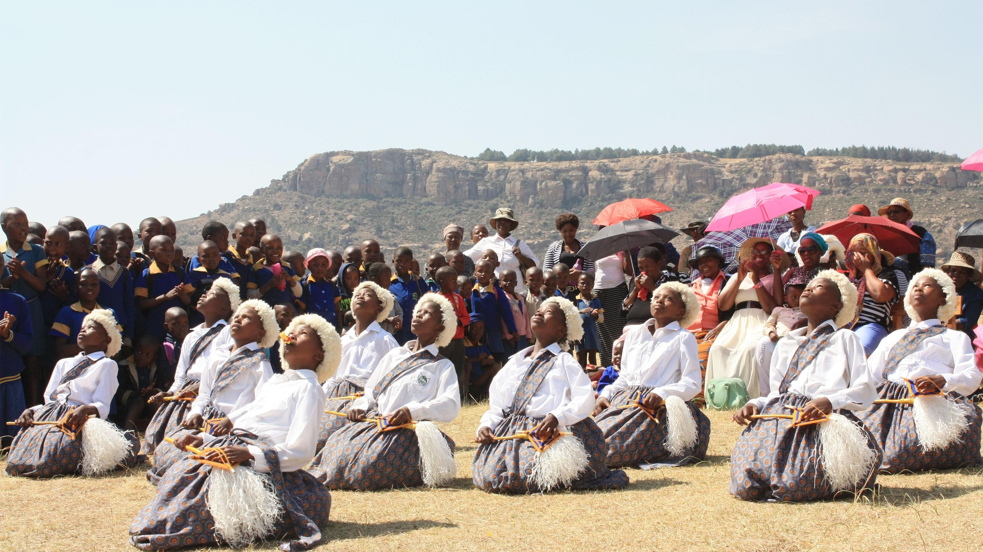 St. Joseph Primary embracing handover of clean water and latrines(celebration Koro Koro)